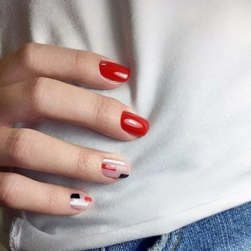 Red Manicure With Feature Nails